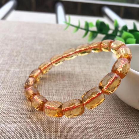 天然巴西黄水晶桶珠手链,20.6克,财富水晶图片