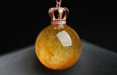 天然钛晶水晶球的真假鉴别方法妙招,钛晶水晶球如何辨别真假?