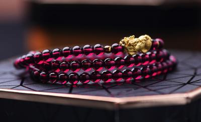 天然紫牙乌石榴石品质好坏怎么看,怎么挑选鉴别紫牙乌的质量?